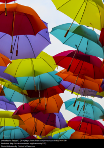 Umbrellas, red, purple, lime green appear to be floating